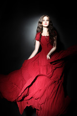 Elegant woman in long dress Red fashion model