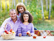 Happy young family on autumn picnic