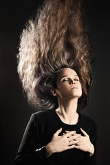 Woman with flying hair style Long hairstyle