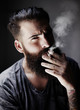 portrait of handsome bearded man with cigarette