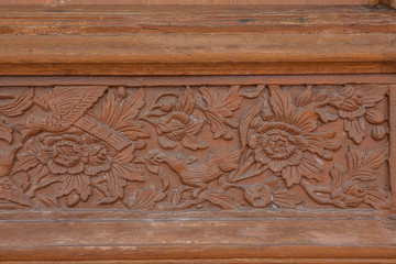 Old brawn carving wooden wall