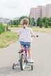 Little girl riding a bicycle in the park.
