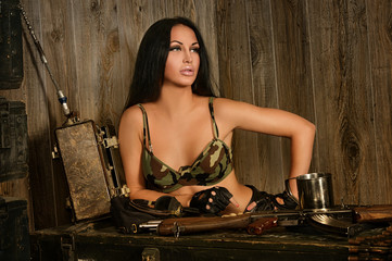 Beautiful sexy woman with army gun