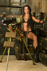 Brunette woman with machine gun