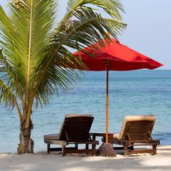 Beach chair and umbrella on the beach , Thailand