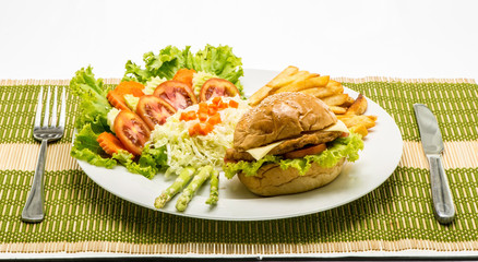 homemade cheese chicken burger with fresh salad on plate