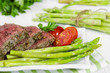 Beef steak medium roast with asparagus and tomatoes