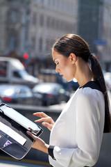 Beautiful business woman reading notepad