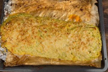 stuffed zucchini on a baking sheet