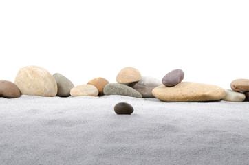 Pebble stones on gray sand