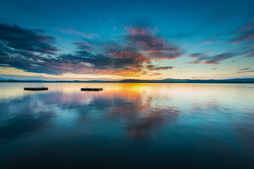 colorful clouds on sunset at lake wallersee with platforms