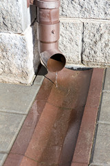 Drain pipe with flowing rain water