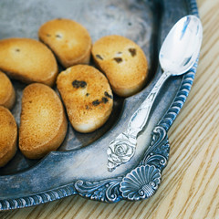 Silver Spoon On Vintage Salver With Cookies