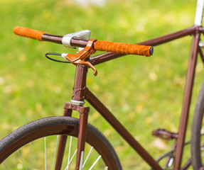 Stylish bicycle on grass