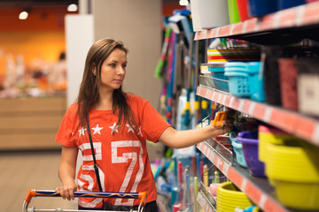 Young woman shopping for cereal, bulk in a grocery supermarket