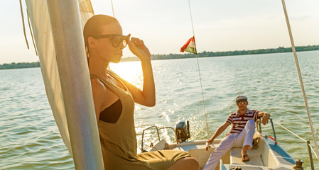 Beautiful woman on a yacht at summer.