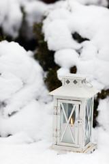 White lantern on snow ground