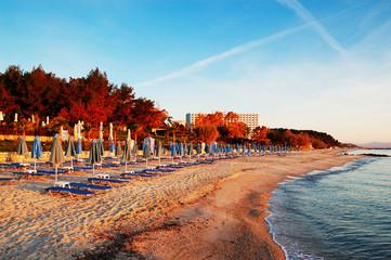 Sunbeds on a beach during sunrise, Halkidiki, Greece