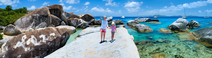 Mother and daughter at scenic coast