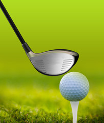 Golf ball and driver on green grass outdoor