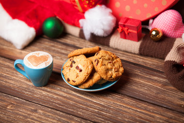Cookie and cup of coffee on christmas background.