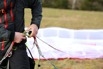 Man fastening his parachute