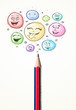 Smiley faces coming out of pencil