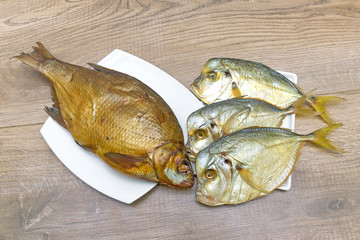 Bream and Vomer closeup on wooden background. horizontal photo.