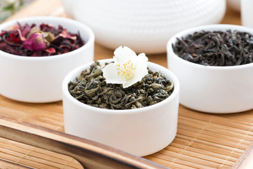 dry herbal teas in white bowls on a tray