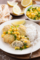 fish cakes with mango salsa and white rice