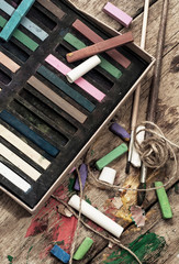 crayons and a brush for painting on wooden background