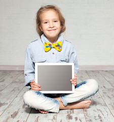 Girl playing laptop computer