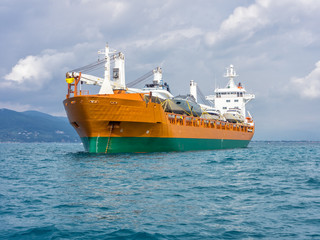 cargo ship moving boats