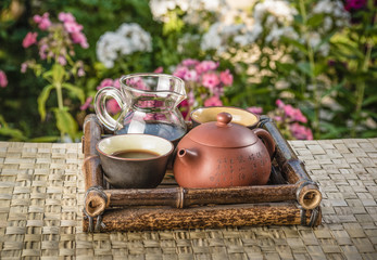 Tea set on a bamboo tray