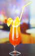 Tasty cocktail on bright background