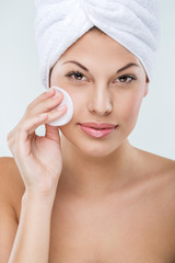 Beautiful woman with perfect skin clean face towel on her head