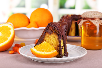 Piece of delicious cake  with oranges