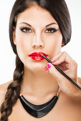 Beautiful attractive woman with luxury make-up and red lipstick