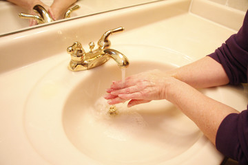 Sanitizing hands in the sink