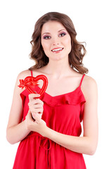 Beautiful young girl in red dress with heart isolated on white