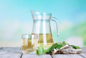 Glass and pitcher of fresh birch sap