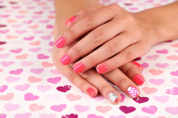 Female hand with stylish colorful nails, on bright background