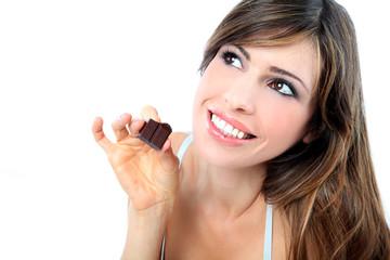 Beautiful girl eating the chocolate