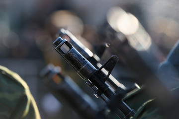 Solders holding a barrel of gun