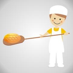 Panadero sacando el pan del horno