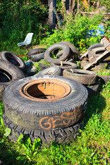 Heap of used tires on junkyard