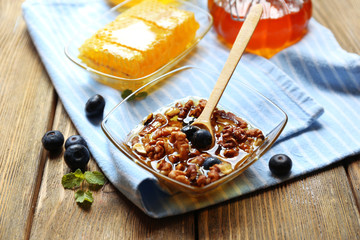 Fresh snack with honey on wooden table