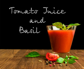 tomato juice with basil on blackboard