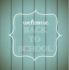 "Chalkboard sign ""back to school"" on wood"