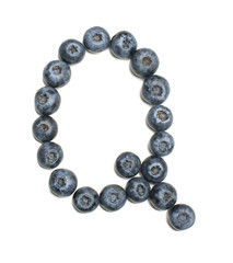 Alphabet letter Q arranged from highbush blueberry isolated